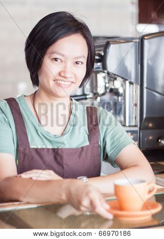 Smiling Asian Barista   Posing With Cup Of Coffee