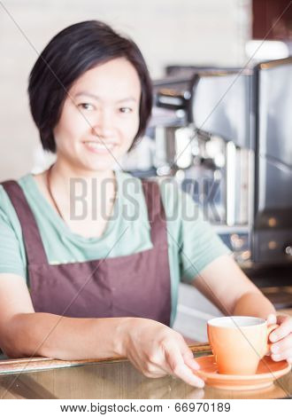 Barista Prepares Freshly Brewed Coffee