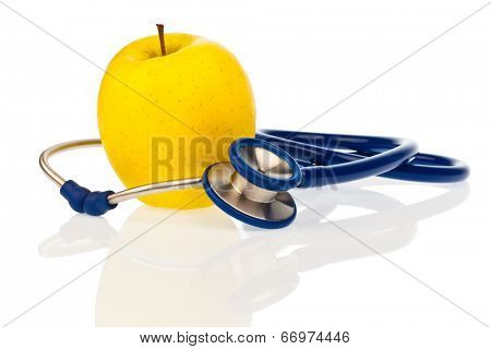 a stethoscope and an apple. symbolic of a healthy diet.