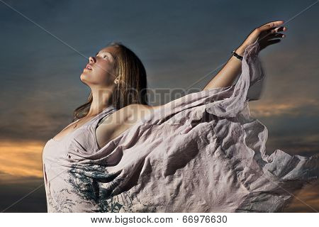 Young Woman Is On Sunset Sky Background