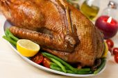 Drumstick of baked Goose with green beans,potatoes,apple,pepper poster
