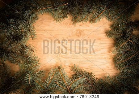 green fir branches on the wooden floor