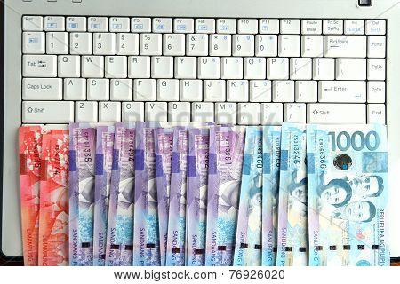 Cash money on a laptop computer