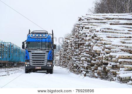 Blue Scania V8 Logging Truck At Snowy Railway Timber Yard