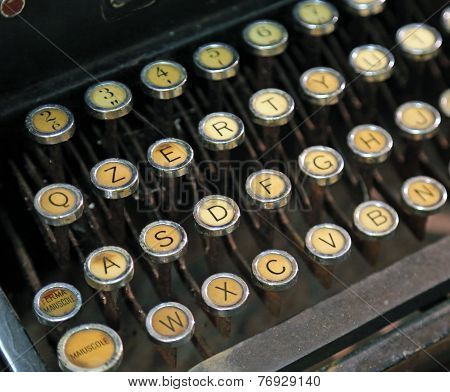 antique typewriter with yellow keys very old keyboard