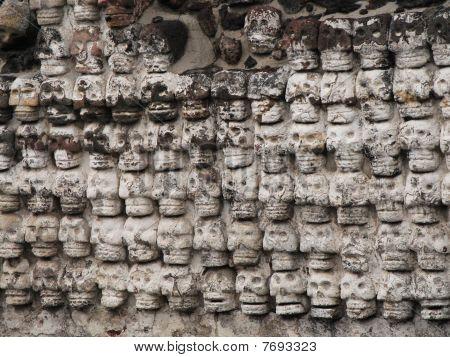 Wall of stone skulls