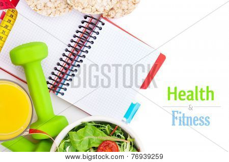 Dumbells, tape measure, healthy food and notepad for copy space. Fitness and health. Isolated on white background