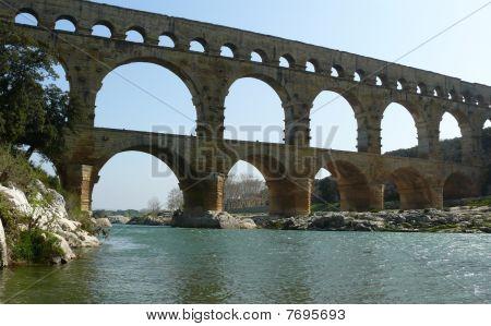 The Roman aquaduct Pont du Gard spanning the river Gardon poster