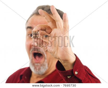 Man Holds Coins With Hand, Mouth Open.