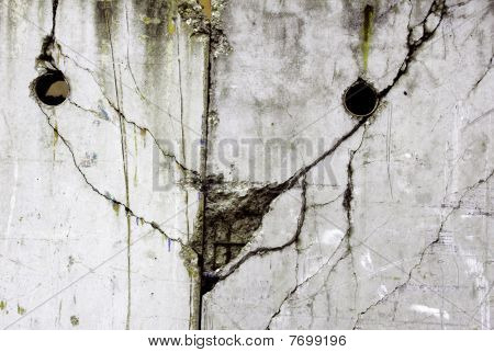 face in a weathered concrete wall
