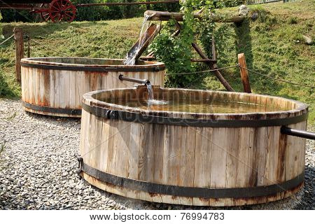 Wooden, flowing water tanks.
