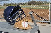 Baseball Helmet Bat and Glove on an Aluminum Bench poster