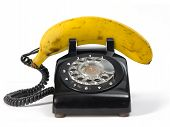 Fresh banana on retro phone. Isolated on white. poster