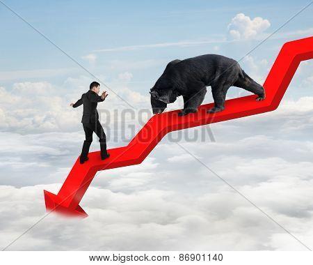 Businessman Against Bear On Arrow Downward Trend Line With Sky