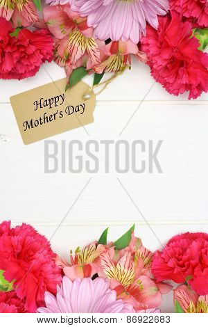 Mother's Day gift tag with flower frame on white wood