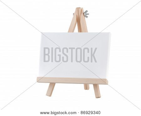 Blank Canvas On Wooden Stand Isolated On White Background
