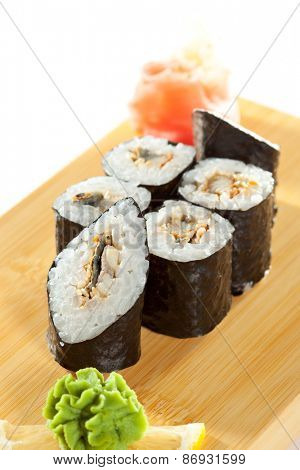 Unagi Maki - Smoked Eel Sushi Roll on the Wooden Plate
