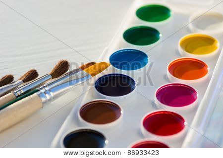 Colorful new watercolor paint pan set and brushes