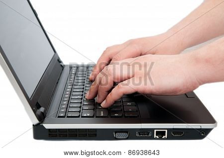 Detail Of Hands Typing On  A Notebook