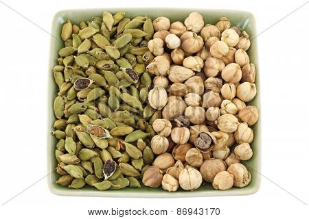 Dried green Cardamon pods and Round Siamese Cardamom (Camphor Seed) isolated on white