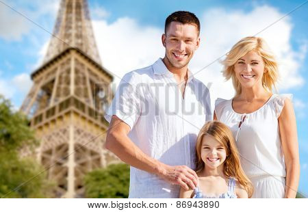 summer holidays, travel, tourism and people concept - happy family in paris over eiffel tower background