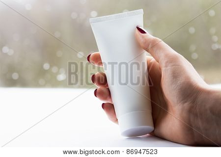Woman Hand With A White Cream Tube