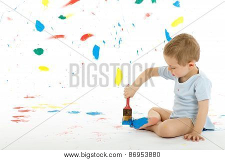 Adorable 3 Year Old Boy Child Creatively Stains On The Wall.