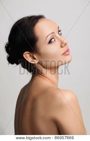 portrait of beautiful brunet women on gray background poster