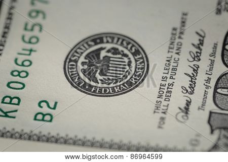 macro photo of federal reserve system symbol on hundred dollar bill