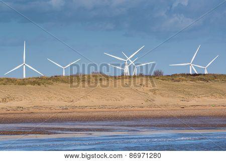 Windfarm Beyond Sand Dunes