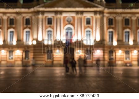 Blurred Image Of The Captiole De Toulouse At Night
