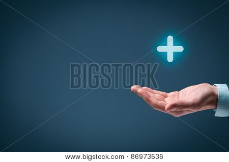 Businessman offer positive thing (like benefits personal development social networking) represented by plus sign. Composition with blank space on left. poster