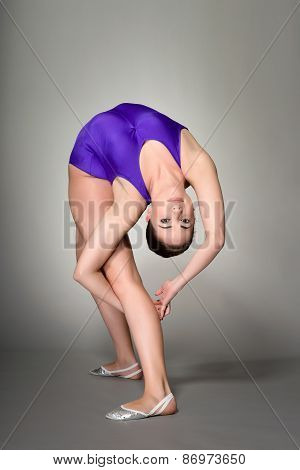 Young Female Contortionist, On Dark Background