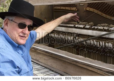 Old Time Piano Player Tickling The Ivories