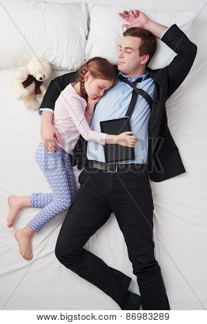 Top view of businessman and his little sleeping daughter