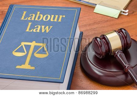 A Law Book With A Gavel - Labour Law
