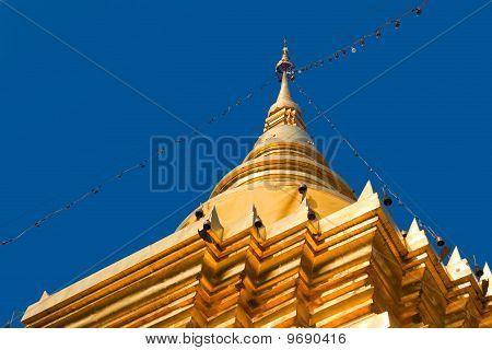 Golden pagoda at Lamphun Thailand