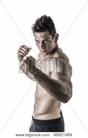 Shirtless male model throwing punch towards camera, isolated on white background poster