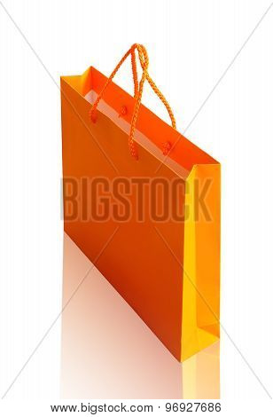 Orange recycle paper shopping bag on white background clipping path.    Stock Photo: Orange recycle paper shopping bag on white background clipping path.