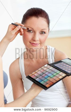 Make-up Artist Putting Some Eye-shadow On A Beautiful Woman