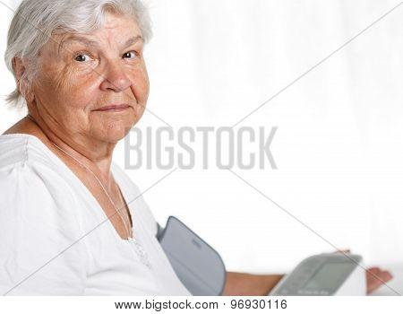 Elder Woman Measuring Blood Pressure