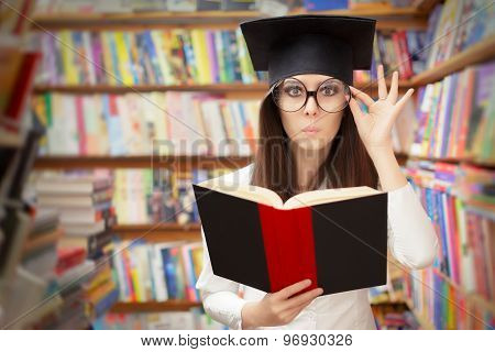 Curious School Student Reading a Book in a Library