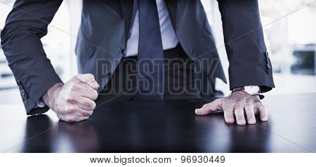 Angry businessman thump the table in his office