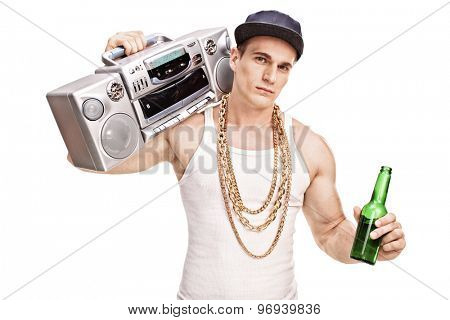 Young male rapper carrying a ghetto blaster over his shoulder and holding a bottle of beer isolated on white background