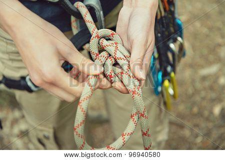 Climber Doing A Figure Eight Knot