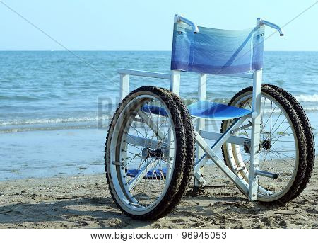 Special wheelchair with wheels and tires to go into the water poster