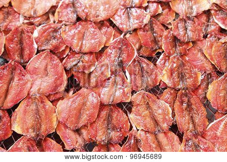 Natural drying of salted fish in Thailand.