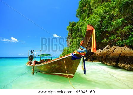 Traditional longtail boat and the clear sea at Phi Phi Don island Andaman sea of Thailand.
