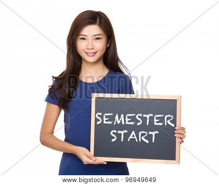 Asian woman with blackboard showing phrase of semester start