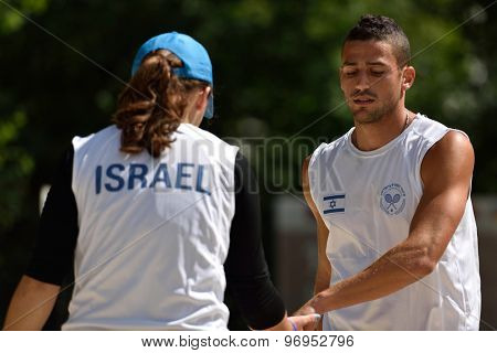 MOSCOW, RUSSIA - JULY 16, 2015: Lior Brik (right) and Alina Menukhin of Israel during the match of ITF Beach Tennis World Team Championship. 28 nations compete in the event this year